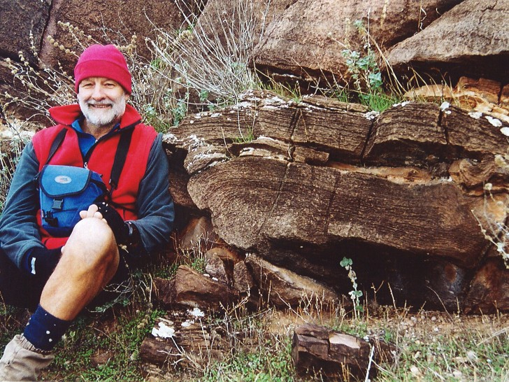 John Lindner sits in front of huge stromatolite fossils, up to one metre wide and 630 million years old, in the Trezona Formation just near Old Elatina Hut ruin. The fine layers are the result of inorganic debris, such as sand and mud, being deposited on the successive gum-like mats produced by cyanobacteria