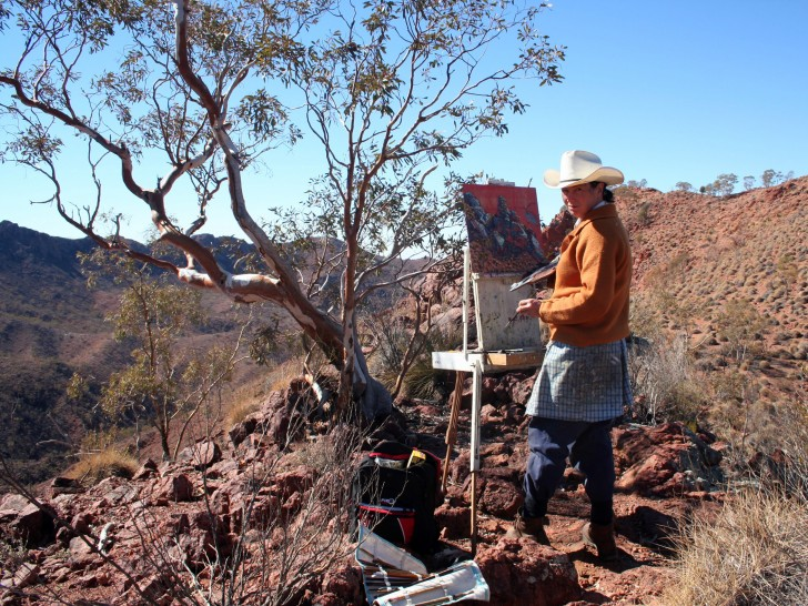 Lucy Culliton painting at Split Rock, Arkaroola