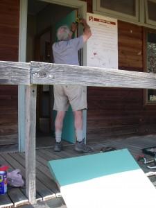 Colin fits a new door to Bowmans Hut