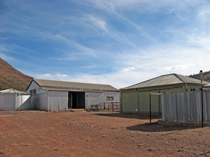 Rear of hut (right) with shearing shed beyond (left)