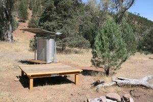 Camping platform and water tank.